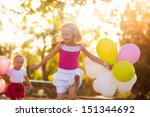 two little girls with balloons... | Shutterstock . vector #151344692