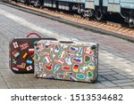 Suitcases With Stickers From...