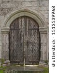 Small photo of Architectural Detail of an Old Oak Wooden Door and Arch in a Country House in the Village of Godolphin in Rural Cornwall, England, UK
