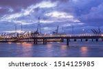Pier In River Scheldt With...