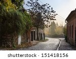 the old cobbled street of the old town in the early morning - stock photo