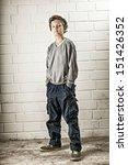 A Teenage Boy  Standing  Hands...