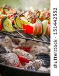 Closeup of hot skewers on the grill - stock photo