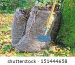 An Autumn Scene With Sacks Of...
