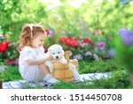 Stock photo beautiful little girl with red hair in a white retro pajamas bathes and washes a white young 1514450708