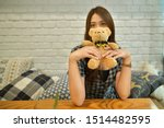 Asian Woman Holding A Teddy...