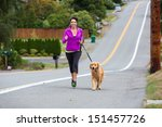 Woman Running With Her Golden...