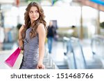 young attractive girl with bags | Shutterstock . vector #151468766
