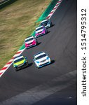 Small photo of Vallelunga, Italy september 14 2019. High angle view of asphalt circuit with Smart electric engine racing car in action during the race, overtaking at turn