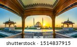 Small photo of Wide angle view of Sharjah New Mosque famous Tourist Destination in Dubai Arabic Letter means: Indeed, prayer has been decreed upon the believers a decree of specified times, Travel and tourism image