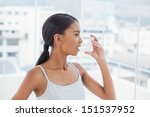pretty model using her asthma... | Shutterstock . vector #151537952