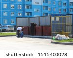 Small photo of Russia, Novosibirsk, June 13, 2015: unemployed dirty homeless vagrants people rummage in city garbage cans antisocial alcoholics