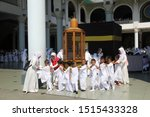Small photo of surabaya-indonesia. 25 September 2019. A group of kindergarten students are practicing Hajj rituals by praying at Maqom Ibrahim. this activity is to instill religious values from an early age.