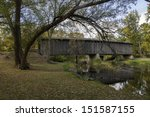Photograph of a historical covered bridge crossing a southern Wisconsin river near Cedarburg.
