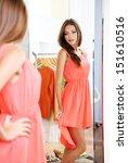 Beautiful Girl Trying Dress...