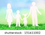 family from paper on grass on... | Shutterstock . vector #151611002