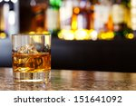 glass of scotch whiskey and ice ... | Shutterstock . vector #151641092