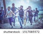 Small photo of MATHURA, INDIA - Feburary 23,2018: Group of boisterous Indian children running for photograph in Agra, Uttar Pradesh, India.