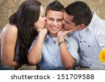 Small photo of Ticklish male child kissed by mother and father