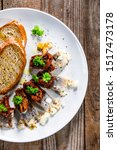 Stock photo marinated herring fillets with slices of bread on white plate on wooden table 1517473178