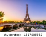 Small photo of View of Eiffel Tower and river Seine at sunrise in Paris, France. Eiffel Tower is one of the most iconic landmarks of Paris. Architecture and landmarks of Paris. Postcard of Paris