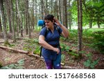 Small photo of person smacks a tiny insect or mosquito bite while hiking