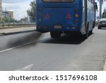 An Auto Bus Polluting The...