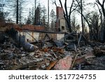 Small photo of Paradise, CA/ United States- March 1, 2019: Remnants of a burned home in Paradise California after the Camp Fire that occurred in November 2018
