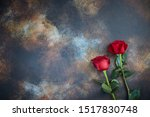 Red Roses Lie On A Textured...
