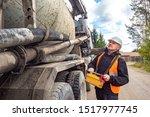 Cement Truck. A Man Controls...