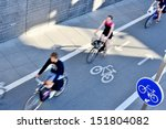 Bicyclists in bike lane seen from above - stock photo