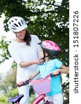 mother and daughter on cycle... | Shutterstock . vector #151807226