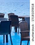 Stock photo cafeteria terrace near the sea nobody on chairs view furniture of cafeteria for tourists 1518105818