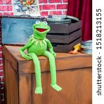 Small photo of Norwich, Norfolk, UK – September 28 2019. A talking Kermit the Frog puppet sat on a wooden box entertaining guest attending the annual Nor-Con movie and comic book convention