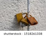 Three Rusted Padlocks On A Pole
