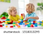 Kids Play With Colorful Blocks. ...