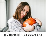 A Young Woman Hugs A Pumpkin...