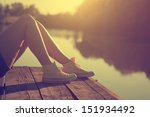 Girl Lying On A Pier