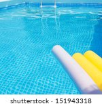 Pool Noodles Floating On The...