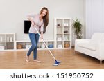 Portrait Of Young Woman Mopping ...