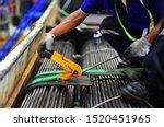 Worker Using Yellow Ratchet Tie ...