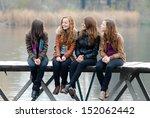 Four School Girls Sitting On...