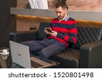 young man working on a laptop... | Shutterstock . vector #1520801498