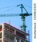 Small photo of Crane. Construction crane. Building crane on the background of the building. Huge crane.