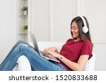 asian woman listening music on... | Shutterstock . vector #1520833688
