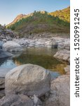 Small photo of brook watercourse on rocks in mountain