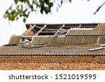 Destroyed Roof Of Brick House....
