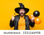 Man With Witch Hat Holding...