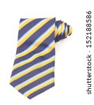 Blue and yellow necktie roled - stock photo