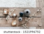 Spring home decor on reclaimed rustic bench, top view of scandinavian interior details.